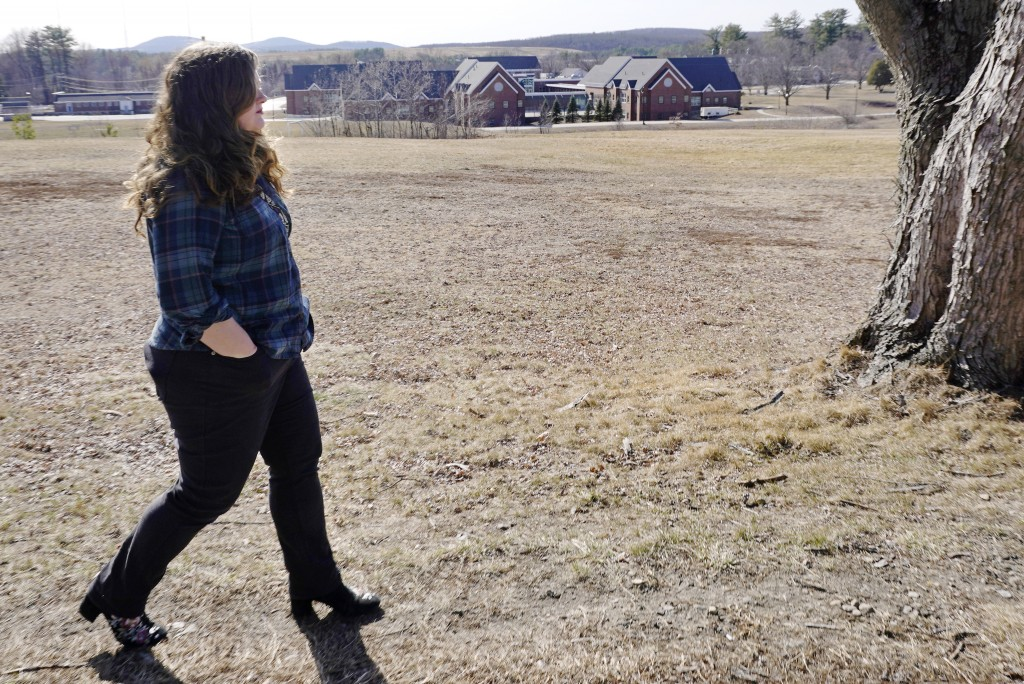 Mary Goddard walks back to her car after being photographed outside the Sununu Youth Development Center, at rear, Tuesday, March 23, 2021, in Manchest...