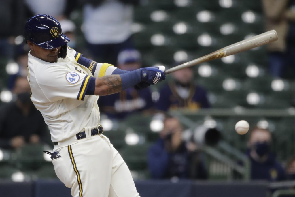 CORRECTS TO HITS AN INFIELD GROUND BALL TO DRIVE IN THE WINNING RUN - Milwaukee Brewers' Orlando Arcia hits an infield ground ball to drive in the win...