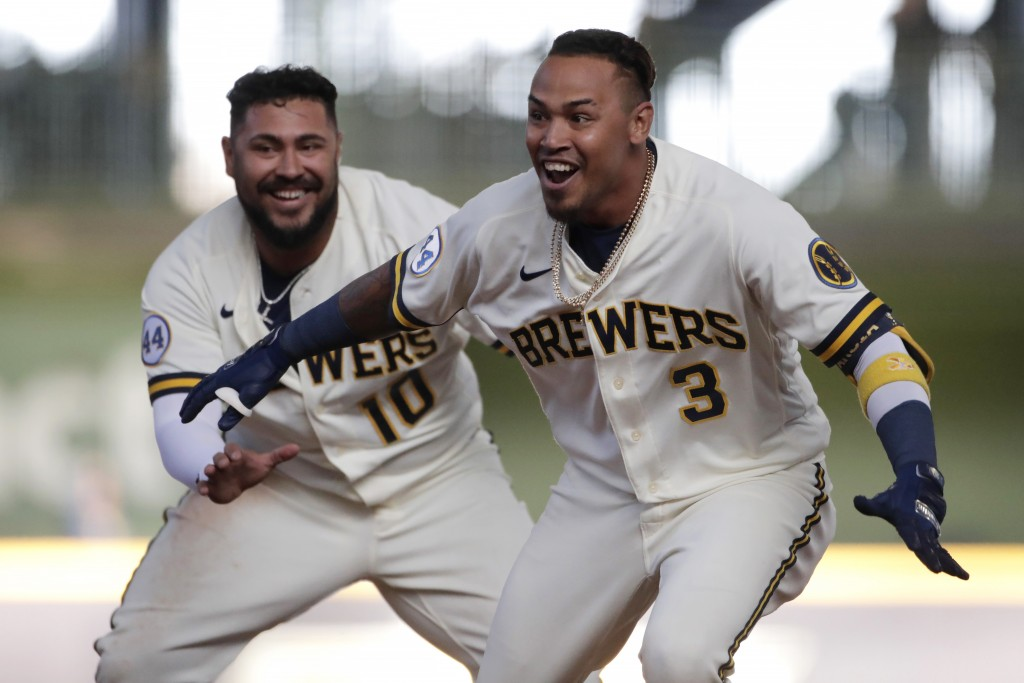 Milwaukee Brewers' Orlando Arcia celebrates with teammates after driving in the winning run during the 10th inning of the team's opening-day baseball ...