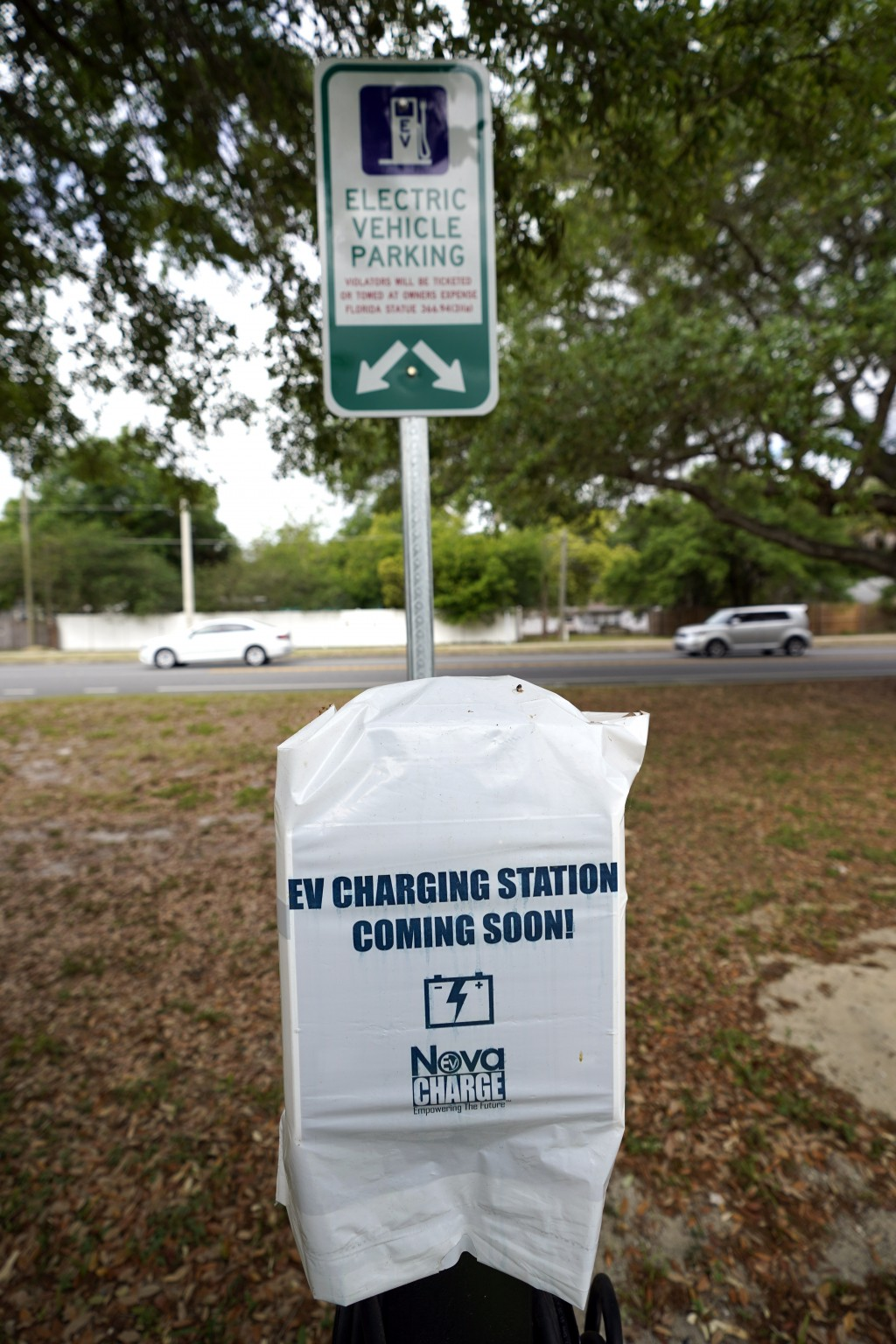 A parking area with charging stations for electric vehicles at a public park is seen Thursday, April 1, 2021, in Orlando, Fla. As part of an infrastru...