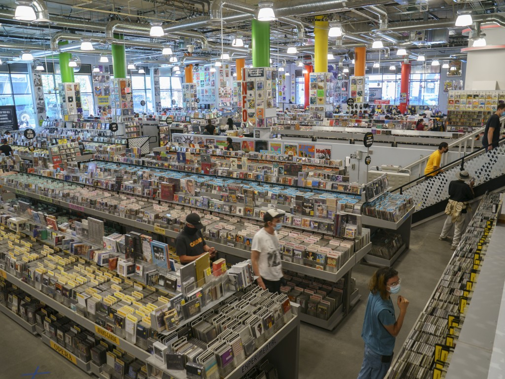 Customers shop at the newly reopened Amoeba Music, the World's largest independent record store, in Los Angeles Friday, April 2, 2021. Most of Califor...