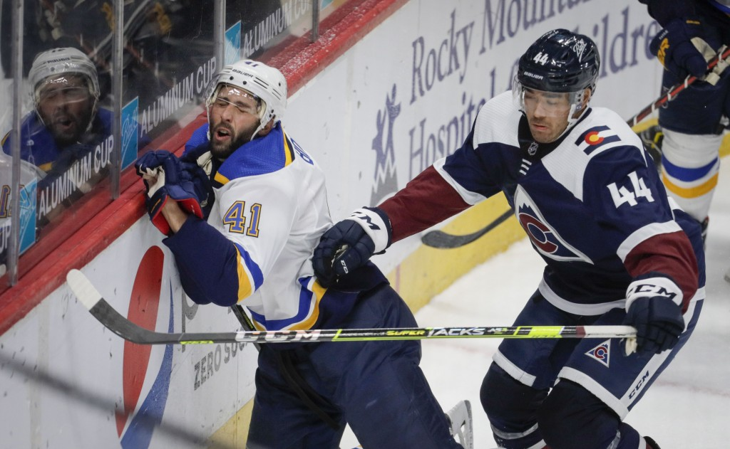 St. Louis Blues defenseman Robert Bortuzzo (41) hits the boards as Colorado Avalanche left wing Kiefer Sherwood (44) chases the puck in the third peri...