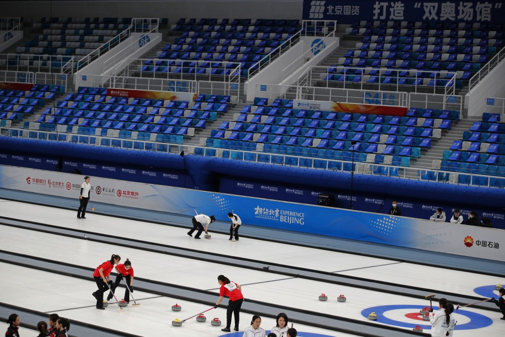 Local teams compete in a curling competition during a test event for the 2022 Beijing Winter Olympics at the National Aquatic Center, also known as th...