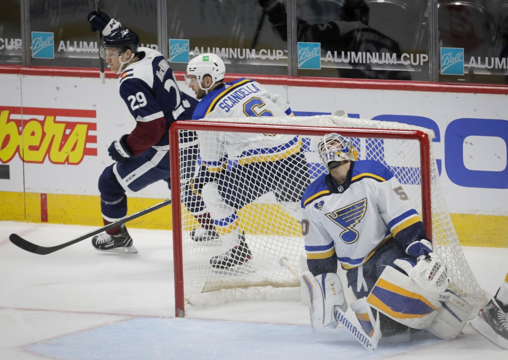 St. Louis Blues goaltender Jordan Binnington (50) reacts to a goal by Colorado Avalanche center Nathan MacKinnon (29) in the second period of an NHL h...