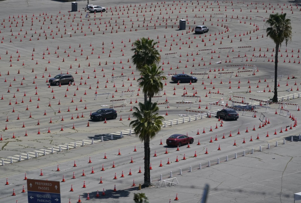 Vehicles drive around a maze of traffic cones, as they line up at the Dodgers Stadium vaccination site in Los Angeles Friday, April 2, 2021. Californi...