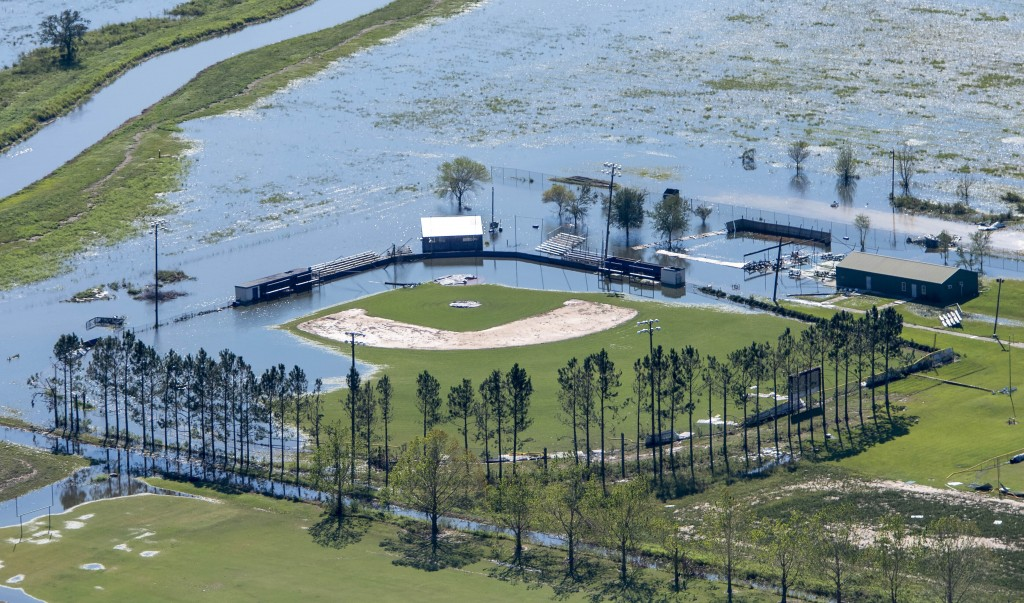 FILE - In this Oct. 10, 2020 file photo, a flooded recreational area is seen in the aftermath of Hurricane Delta  in Iowa, La. Hurricane Delta, which ...