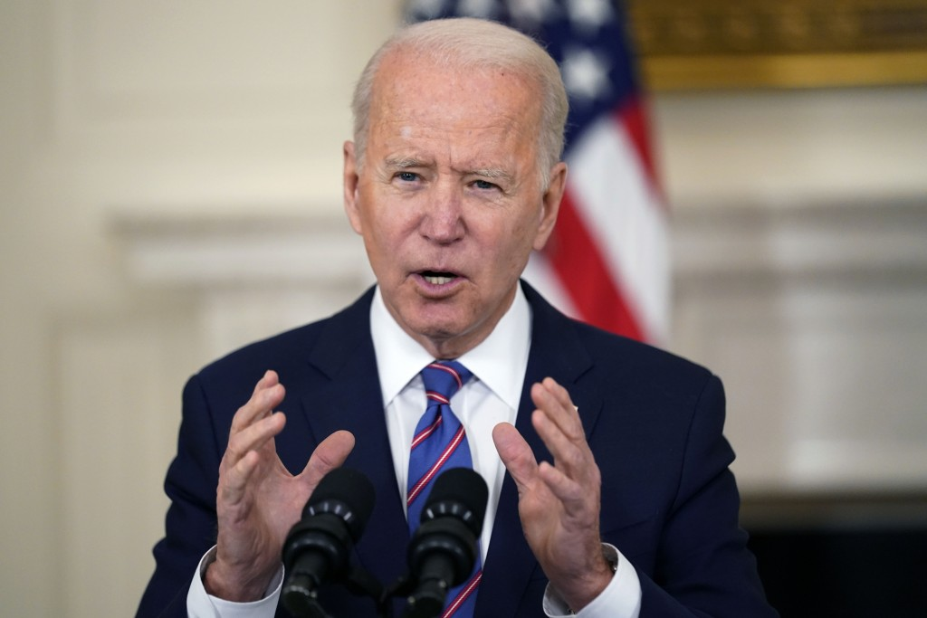 FILE - In this Friday, April 2, 2021 file photo, President Joe Biden speaks about the March jobs report in the State Dining Room of the White House, F...