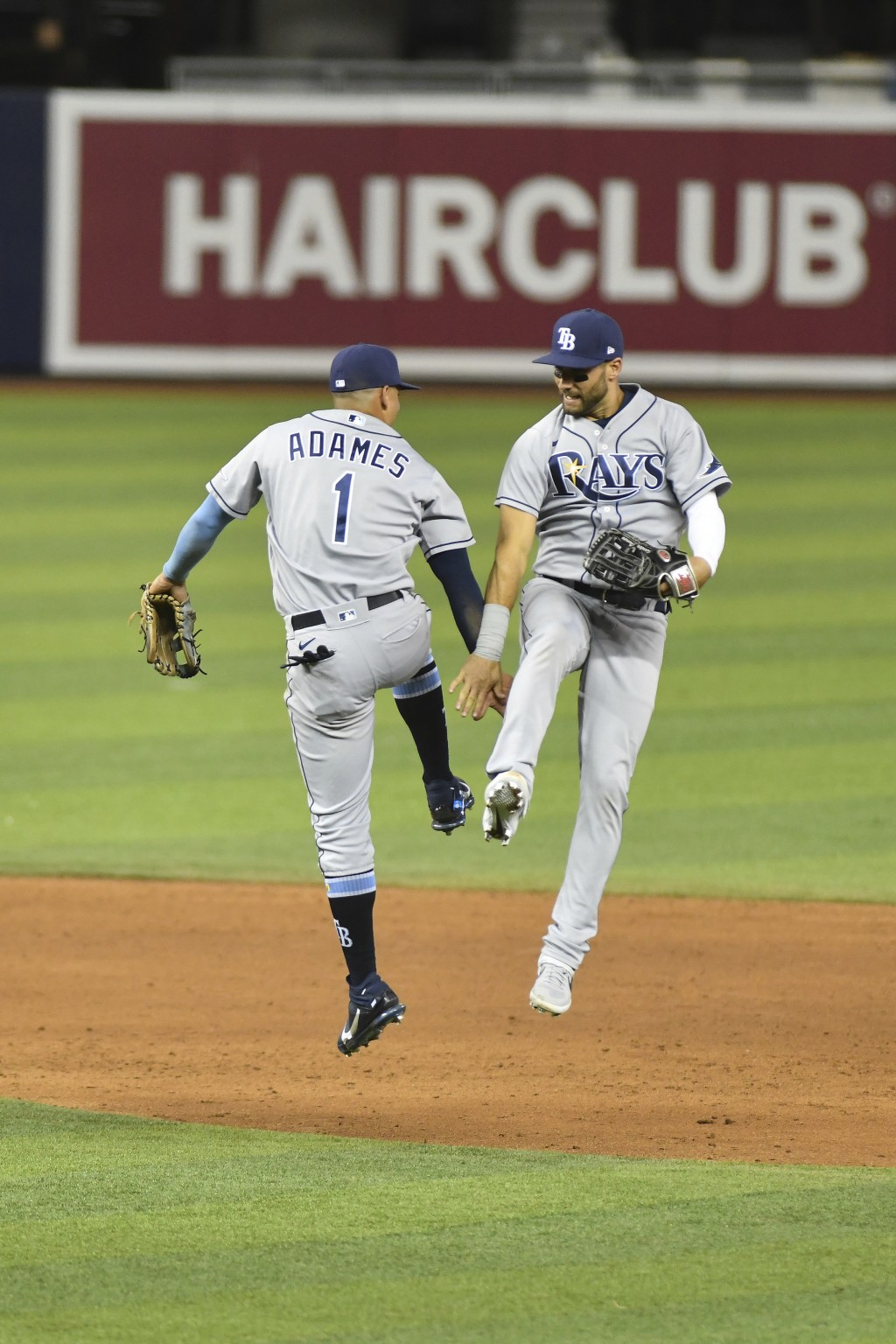 Tampa Bay Rays shortstop Willy Adames, left, and center fielder Kevin Kiermaier celebrate after defeating the Miami Marlins in a baseball game Friday,...