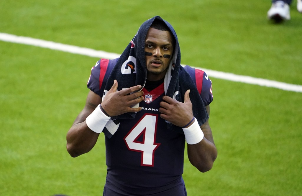 FILE - In this Jan. 3, 2021, file photo, Houston Texans quarterback Deshaun Watson walks off the field before the team's NFL football game against the...