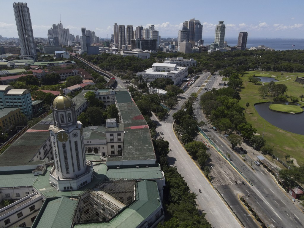 The Manila City Hall stands beside an almost empty road as the government implements a strict lockdown to prevent the spread of the coronavirus on Goo...