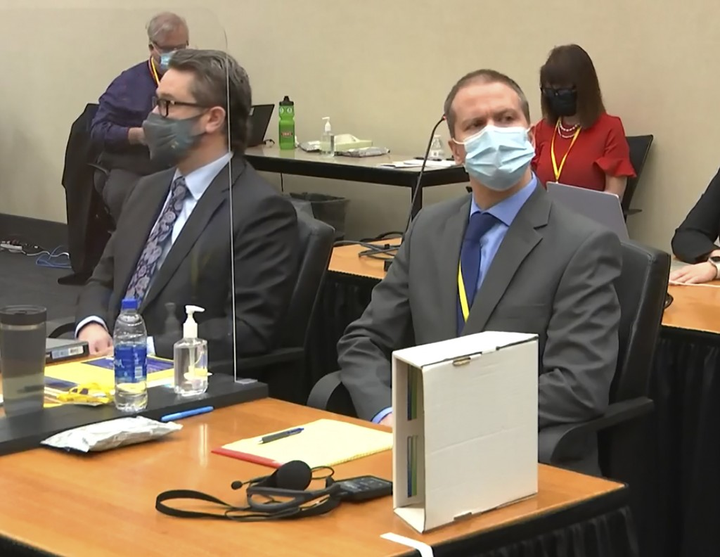 FILE - In this March 29, 2021 file image from video, defense attorney Eric Nelson, left, and former Minneapolis police officer Derek Chauvin listen as...