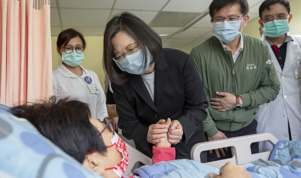 In this photo released by the Taiwan Presidential Office, Taiwan President Tsai Ing-wen visits those injured in Friday's train derailment at a near by...