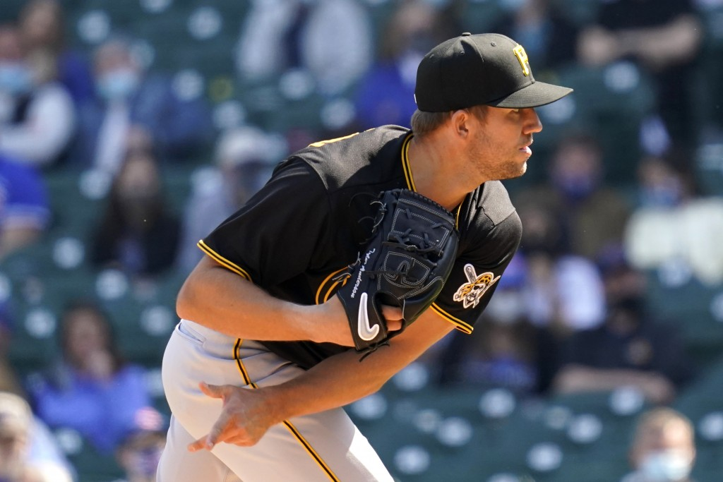 Pittsburgh Pirates starting pitcher Tyler Anderson throws against the Chicago Cubs during the first inning of a baseball game in Chicago, Saturday, Ap...