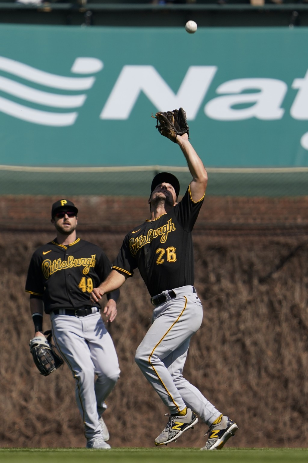 Pittsburgh Pirates second baseman Adam Frazier (26) catches a fly ball by Chicago Cubs' Willson Contreras during the third inning of a baseball game i...