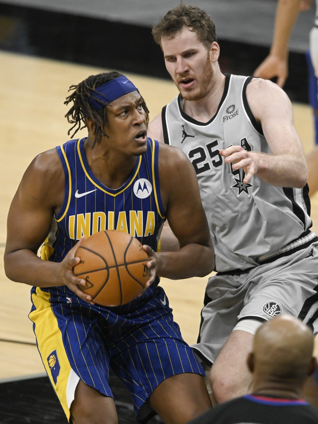 Indiana Pacers' Myles Turner, left, drives against San Antonio Spurs' Jakob Poeltl during the second half of an NBA basketball game on Saturday, April...