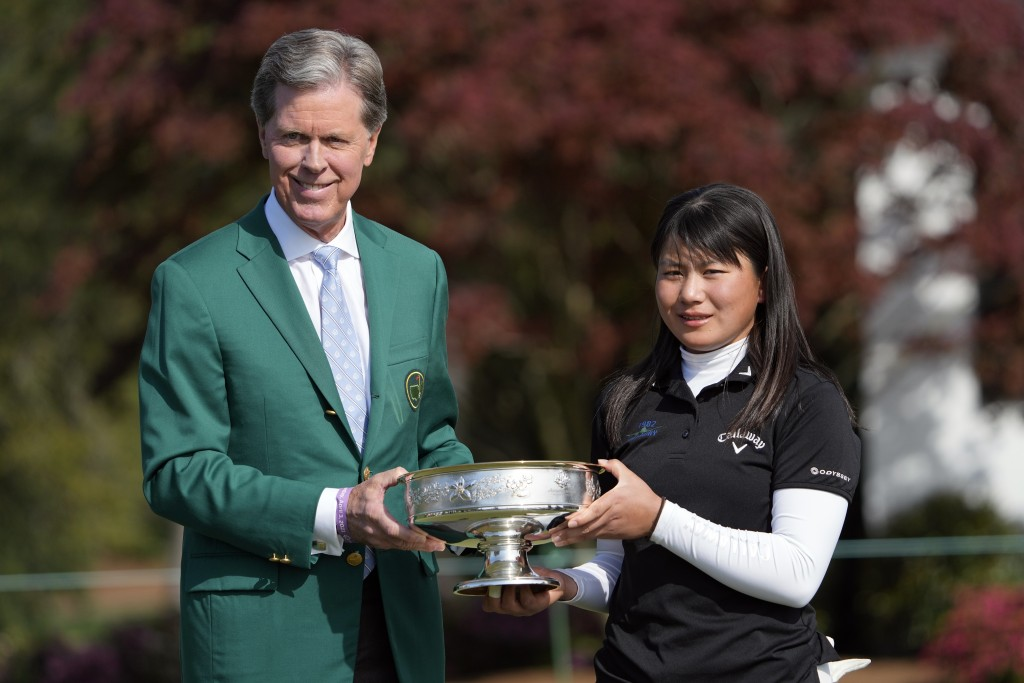 Tsubasa Kajitani, right, of Japan, and Augusta National Golf Club Chairman Fred Ridley pose with the winner's trophy after she won the Augusta Nationa...