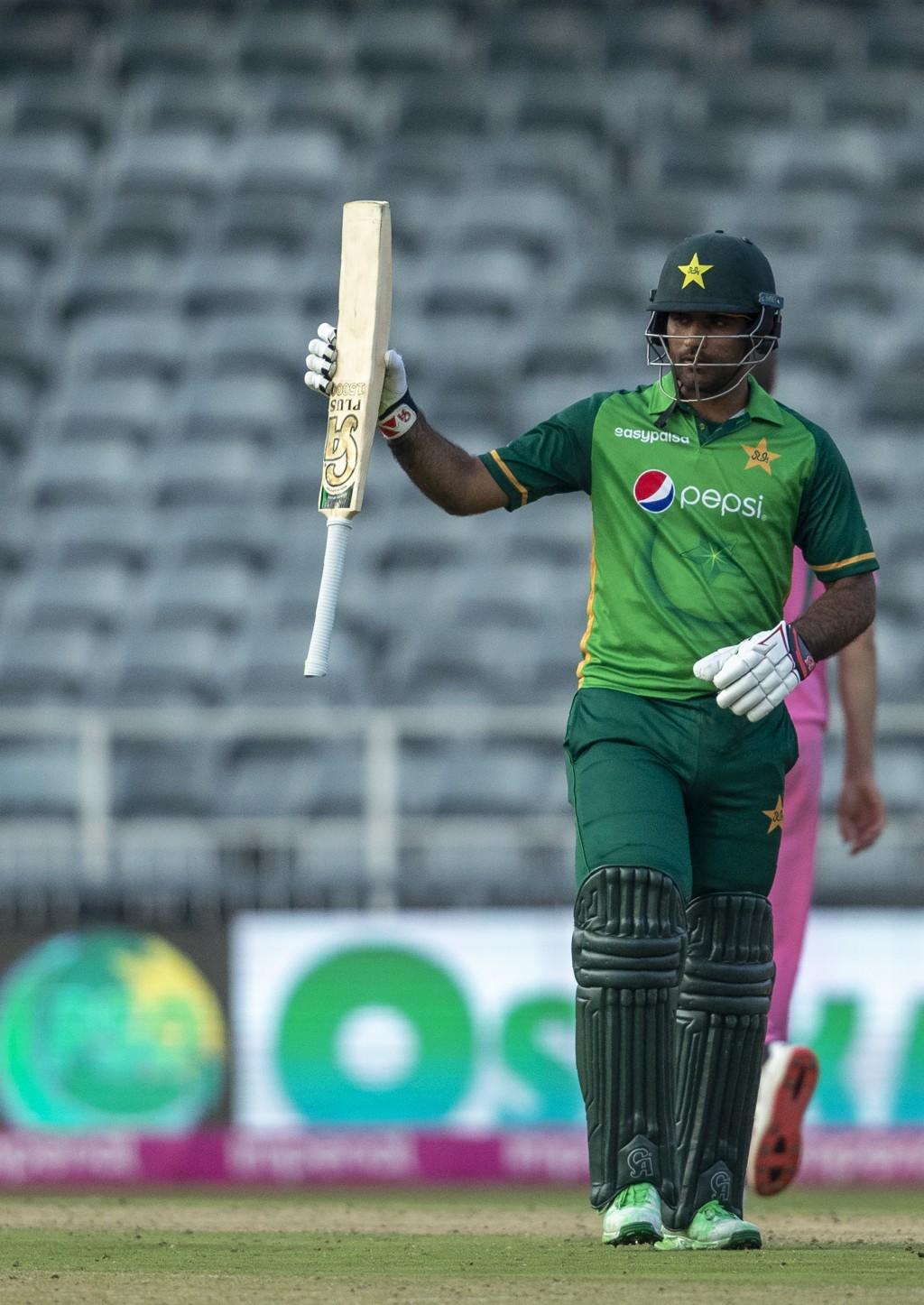 Pakistan's batsman Fakhar Zaman raises his bat to celebrate scoring a century during the second One Day International cricket match between South Afri...