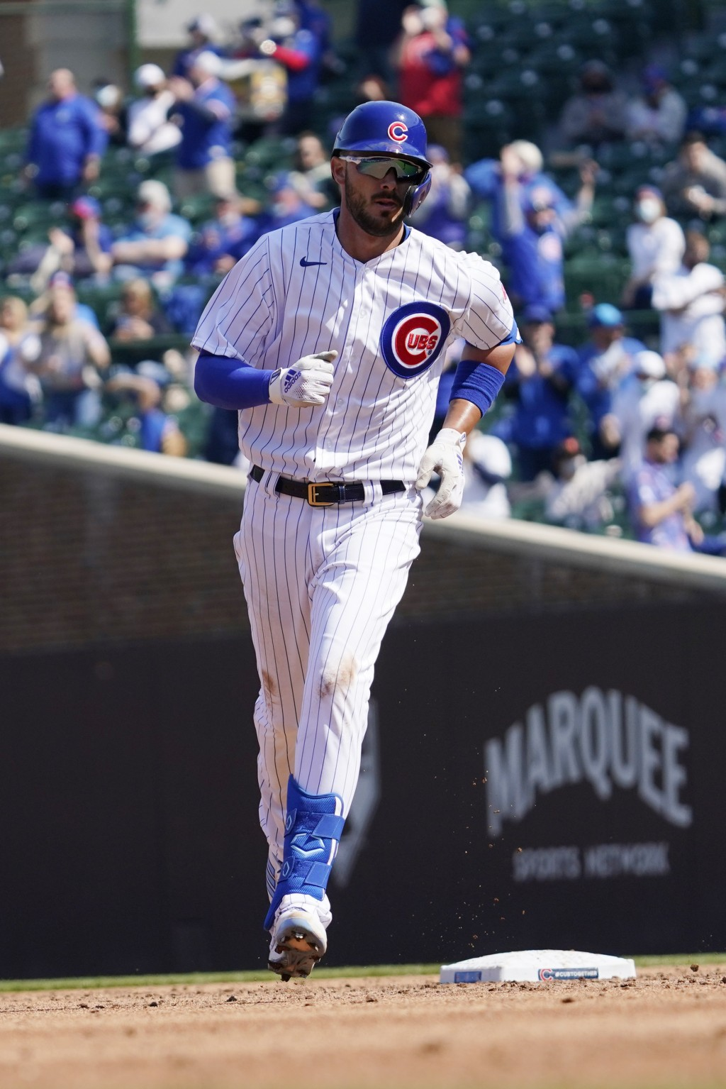 Chicago Cubs' Kris Bryant rounds the bases after hitting a solo home run during the third inning of a baseball game against the Pittsburgh Pirates in ...