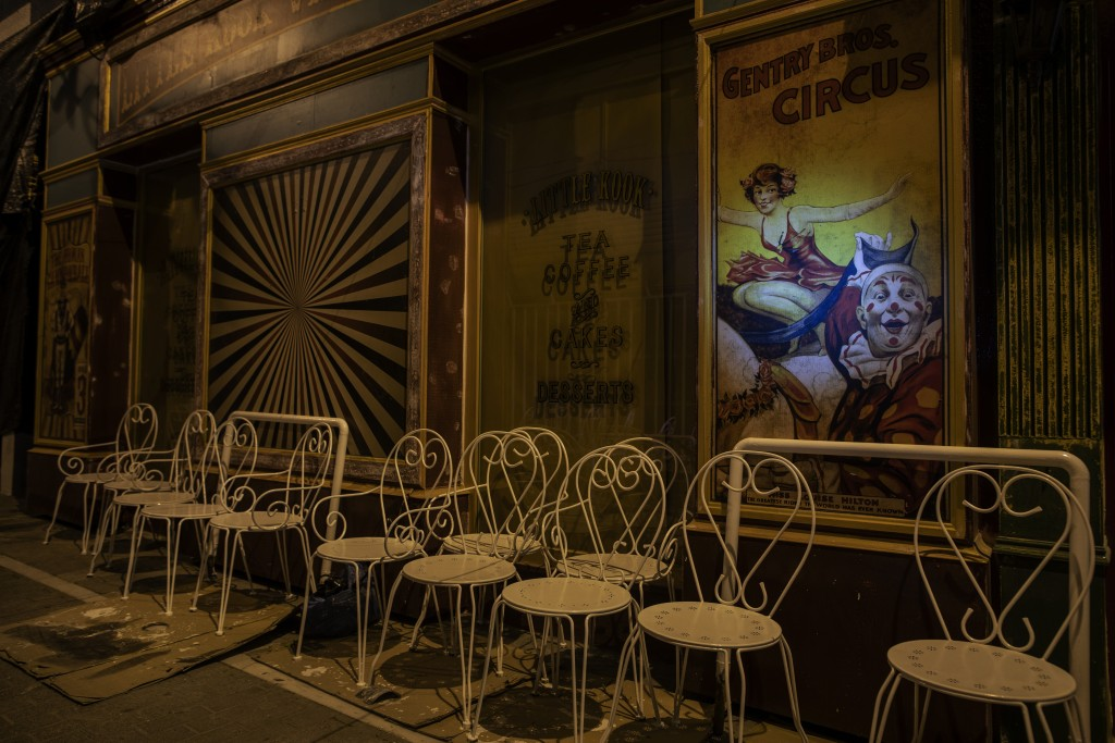 Freshly painted white iron chairs stand outside a coffee shop in Psyri, district of Athens, on Thursday, March 18, 2021. Restaurants, bars and cafes, ...