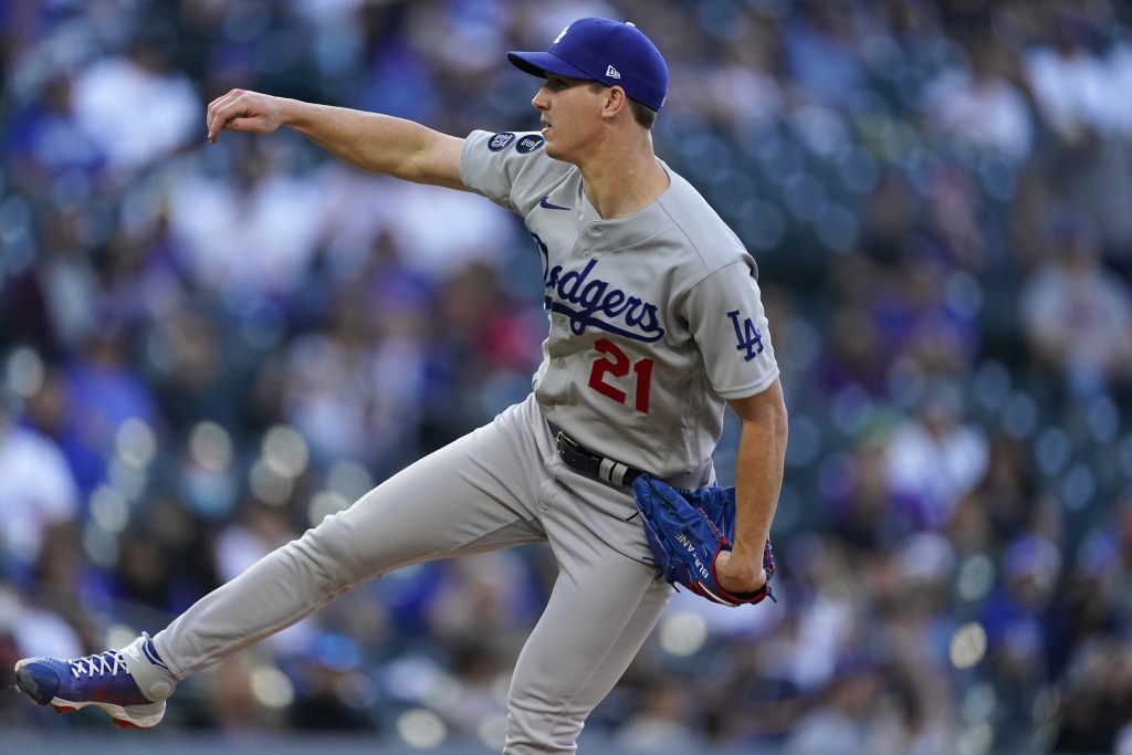 Los Angeles Dodgers starting pitcher Walker Buehler works against the Colorado Rockies in the first inning of a baseball game Saturday, April 3, 2021,...