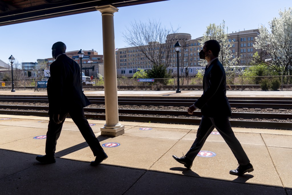 FILE - In this March 30, 2021, file photo Transportation Secretary Pete Buttigieg, right, departs a news conference to announce the expansion of commu...