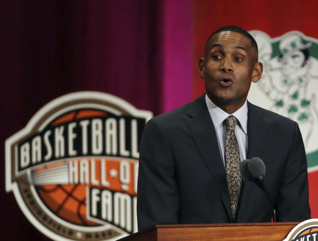 FILE - In this Sept. 7, 2018 file photo, Grant Hill speaks during induction ceremonies at the Basketball Hall of Fame in Springfield, Mass.  USA Baske...