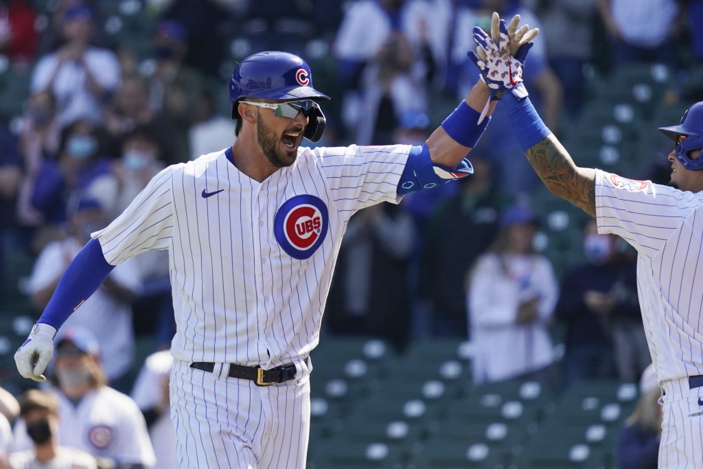 Chicago Cubs' Kris Bryant, left, celebrates with teammate Javier Baez after hitting a solo home run during the third inning of a baseball game against...