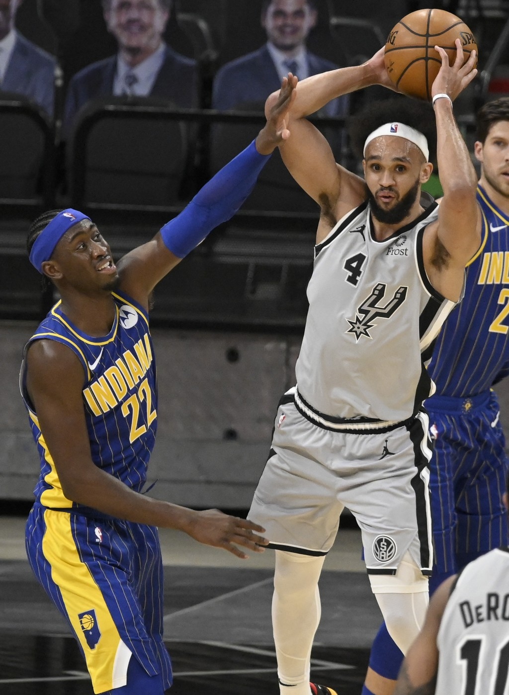 San Antonio Spurs' Derrick White (4) looks to pass as he is defended by Indiana Pacers' Caris LeVert during the second half of an NBA basketball game ...