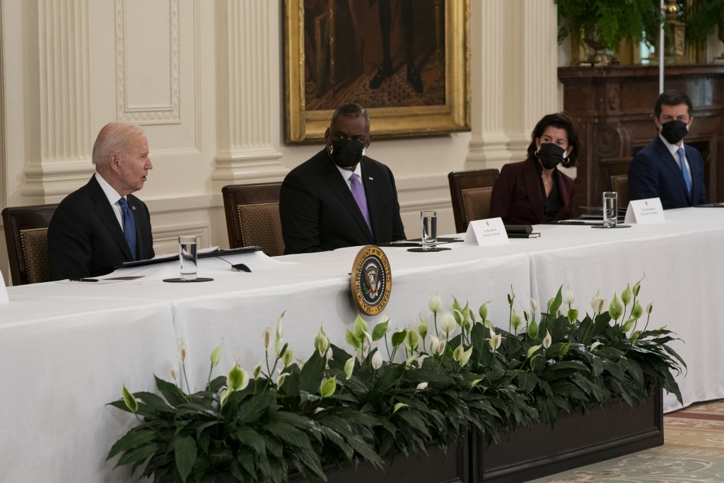 FILE - In this April 1, 2021, file photo President Joe Biden speaks during a Cabinet meeting in the East Room of the White House in Washington. From l...