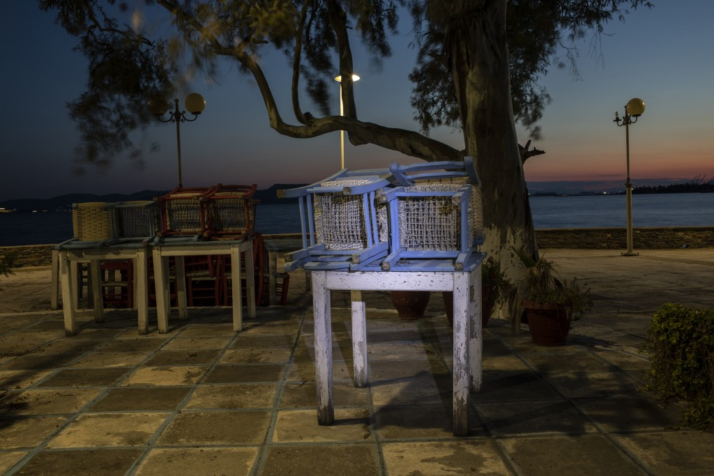 Tables and chairs outside a shuttered traditional fish restaurant in Aspropyrgos, a northwest suburb of Athens, on Friday, March 26, 2021. Restaurants...