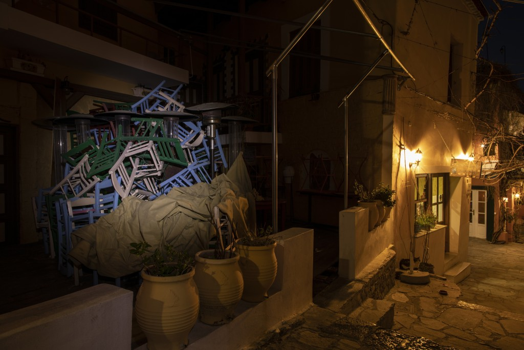 Chairs, tables and heaters are piled outside a shuttered traditional restaurant in Plaka, district of Athens, on Tuesday, March 16, 2021. Restaurants,...