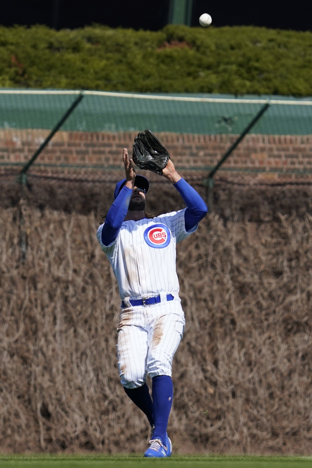Chicago Cubs center fielder Jake Marisnick catches a fly ball by Pittsburgh Pirates' Adam Frazier during the third inning of a baseball game in Chicag...