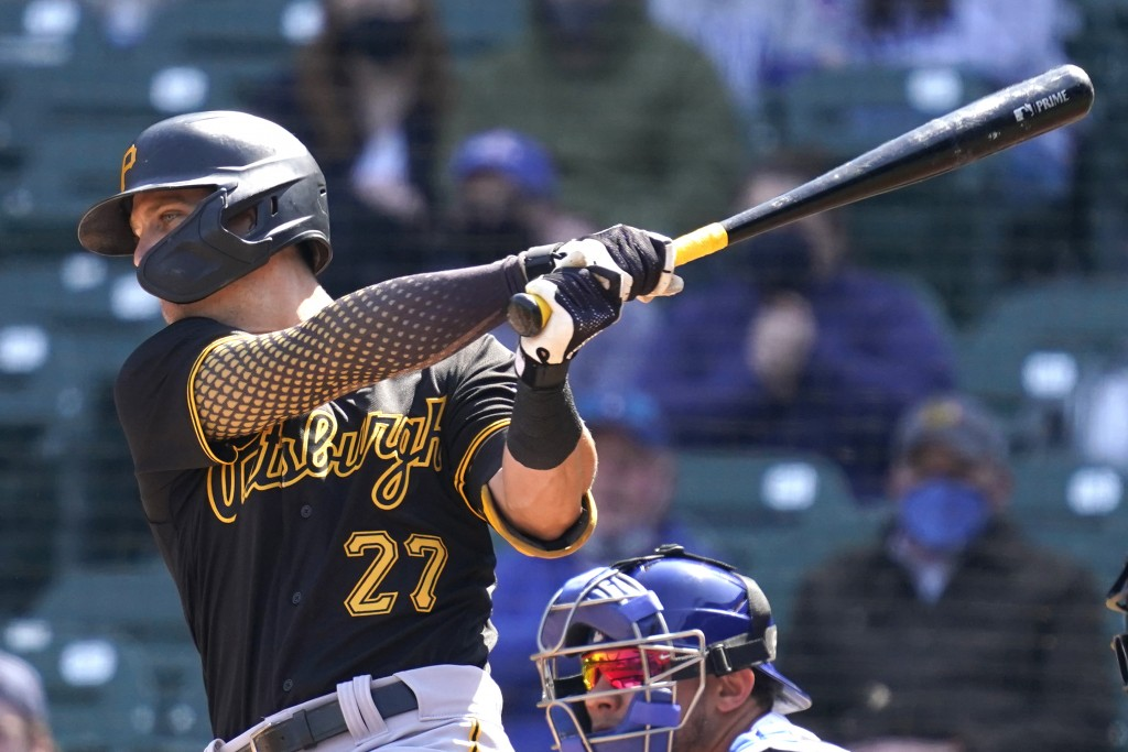 Pittsburgh Pirates shortstop Kevin Newman hits a one-run single against the Chicago Cubs during the first inning of a baseball game in Chicago, Saturd...