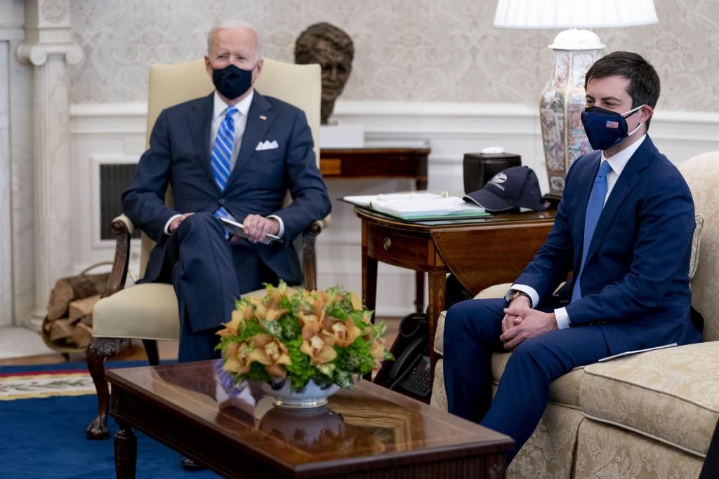 FILE - In this March 4, 2021, file photo, President Joe Biden and Transportation Secretary Pete Buttigieg, right, meet with Vice President Kamala Harr...