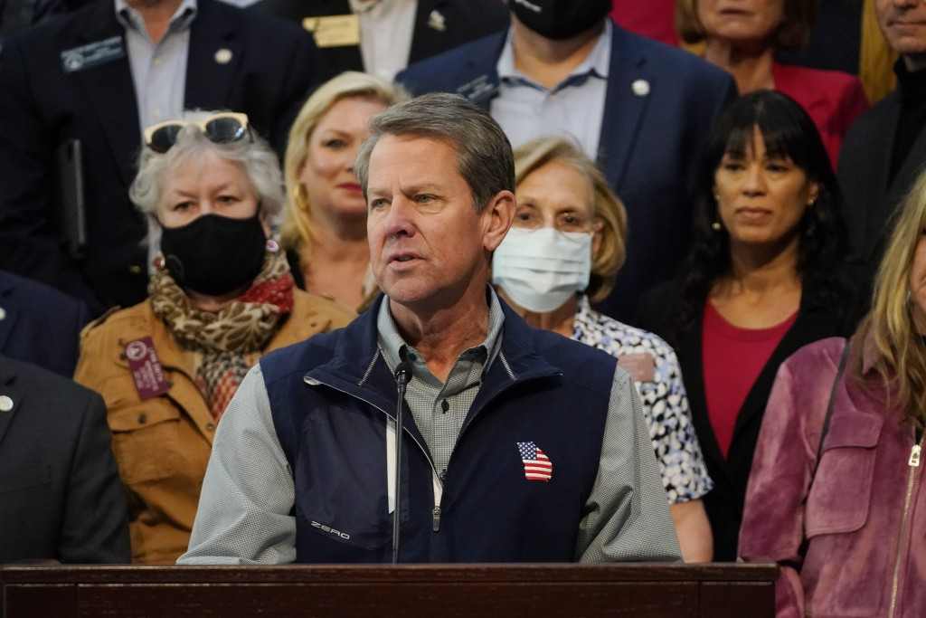 Georgia Gov. Brian Kemp speaks during a news conference at the State Capitol on Saturday, April 3, 2021, in Atlanta, about Major League Baseball's dec...
