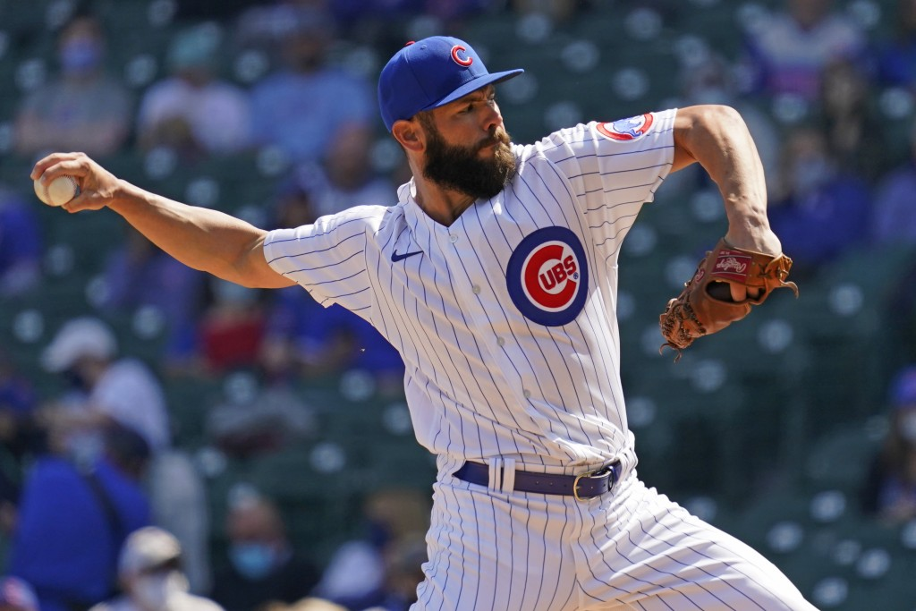 Chicago Cubs starting pitcher Jake Arrieta throws against the Pittsburgh Pirates during the first inning of a baseball game in Chicago, Saturday, Apri...