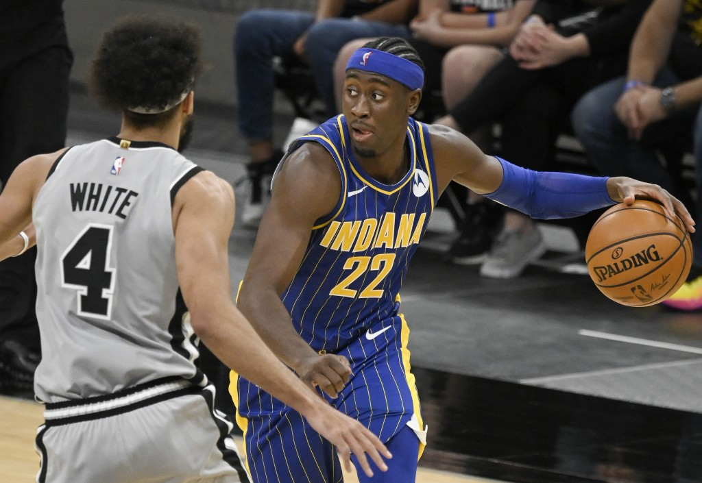 Indiana Pacers' Caris LeVert (22) drives against San Antonio Spurs' Derrick White during the second half of an NBA basketball game Saturday, April 3, ...