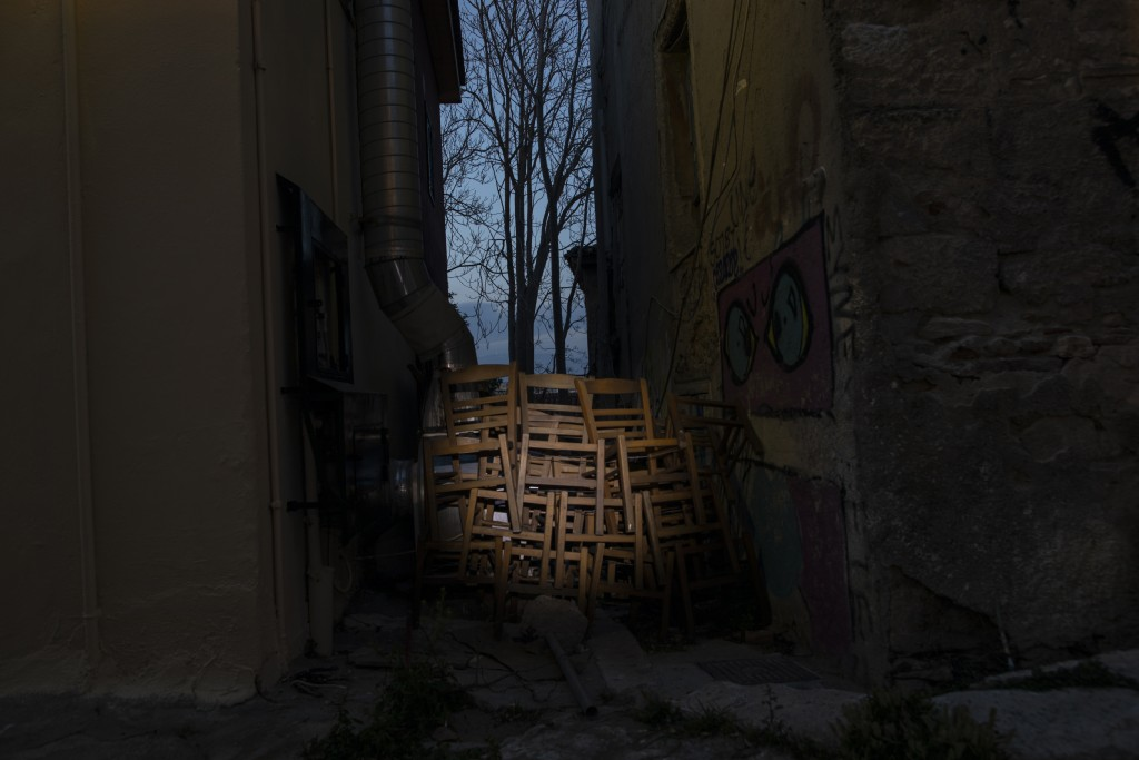 Chairs are stored outside a shuttered coffee shop in Plaka, district of Athens, on Monday, March 29, 2021. Restaurants, bars and cafes, whose nature i...