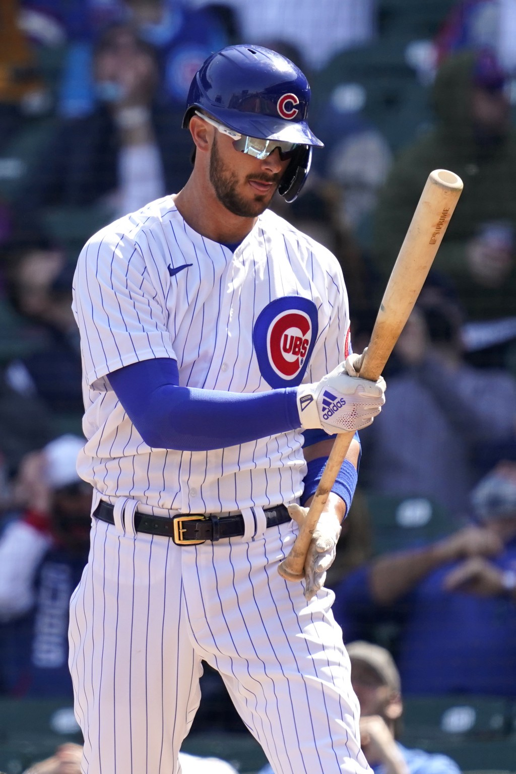 Chicago Cubs' Kris Bryant checks his bat during the first inning of a baseball game against the Pittsburgh Pirates in Chicago, Saturday, April 3, 2021...