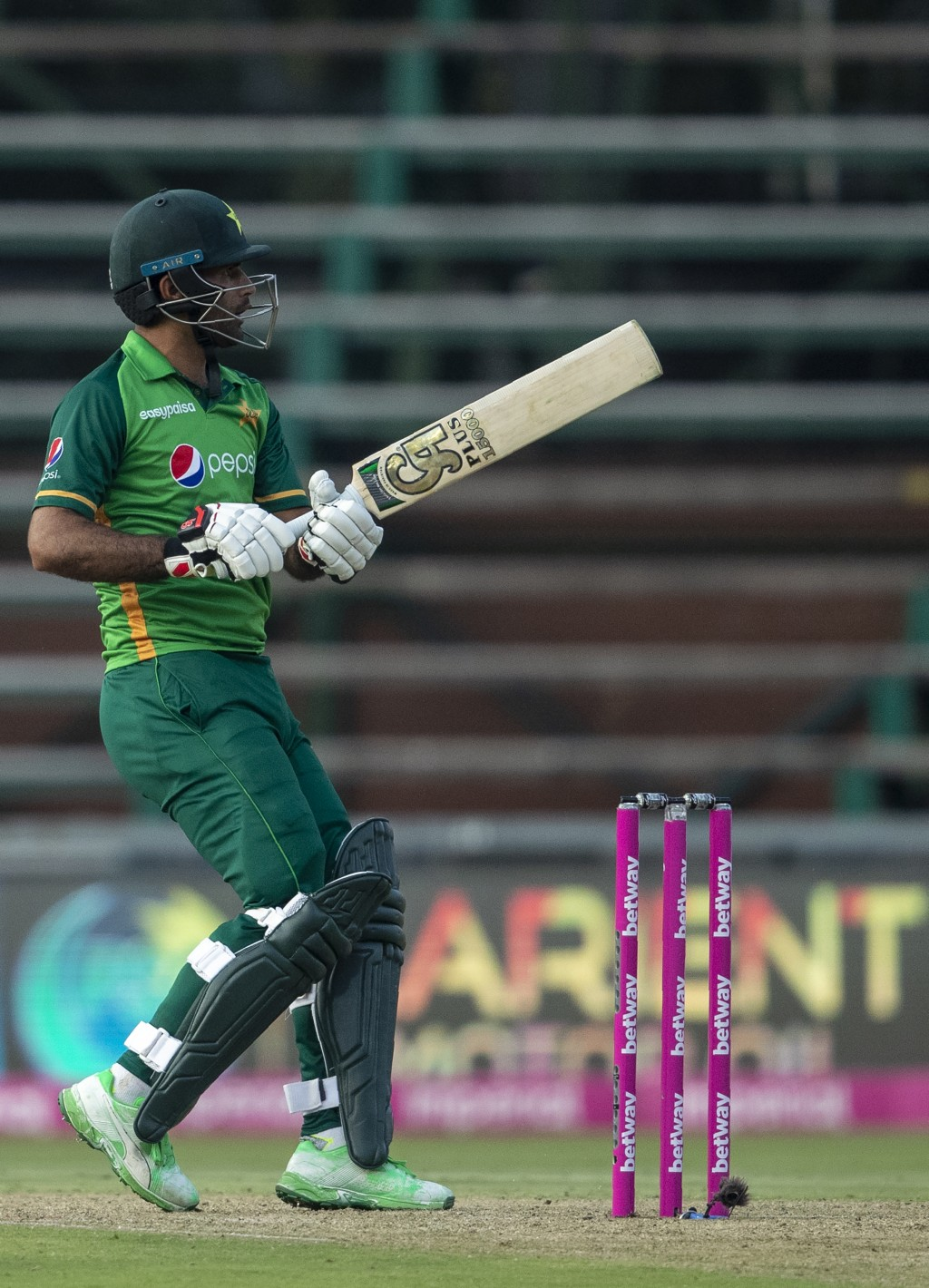 Pakistan's batsman Fakhar Zaman watches his shot hit a boundary to score a century during the second One Day International cricket match between South...