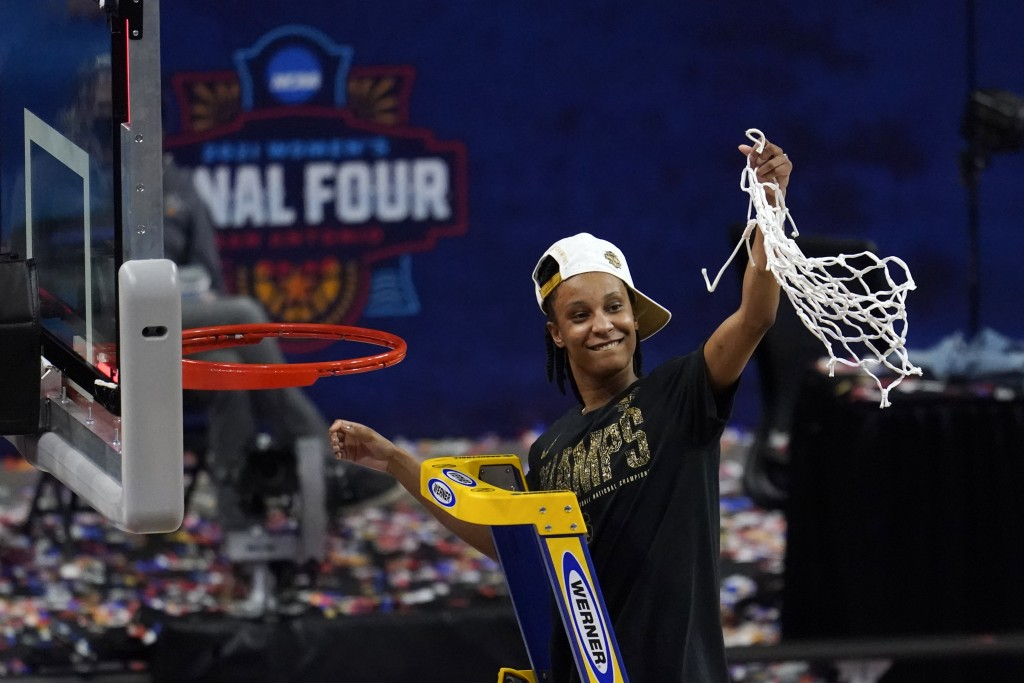 Stanford guard Kiana Williams (23) cuts down the net after the championship game against Arizona in the women's Final Four NCAA college basketball tou...