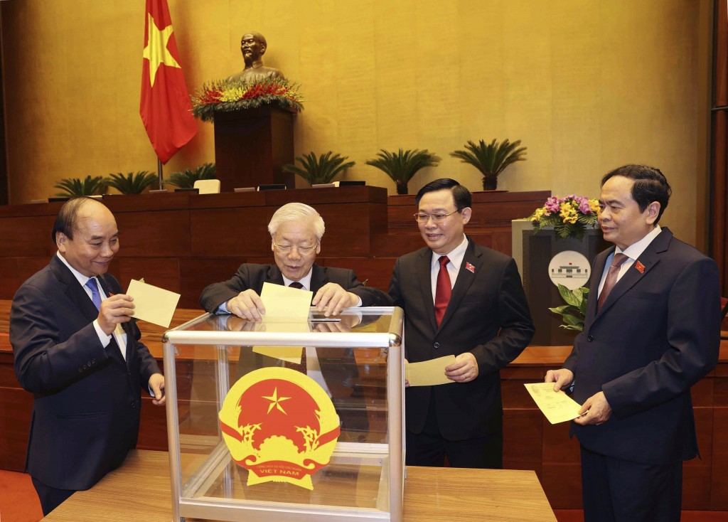 Vietnamese leaders cast ballot to elect new Prime Minister, from left, President Nguyen Xuan Phuc, Communist General Secretary Nguyen Phu Trong, Chair...