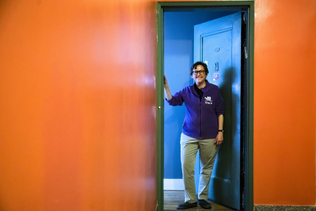 FILE - In this April 6, 2020, file photo, Rabbi Sharon Kleinbaum poses for a photograph at the door to her apartment in New York. The pandemic has rem...