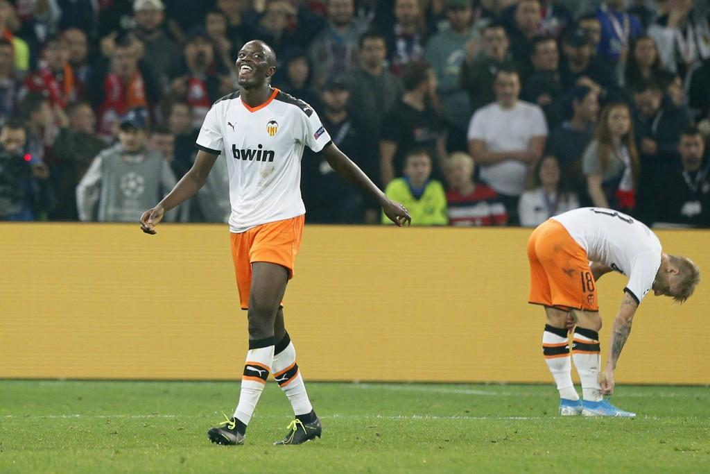 FILE - In this Oct. 23, 2019, file photo, Valencia's Mouctar Diakhaby, left, leaves the pitch after receiving a red card during the group H Champions ...