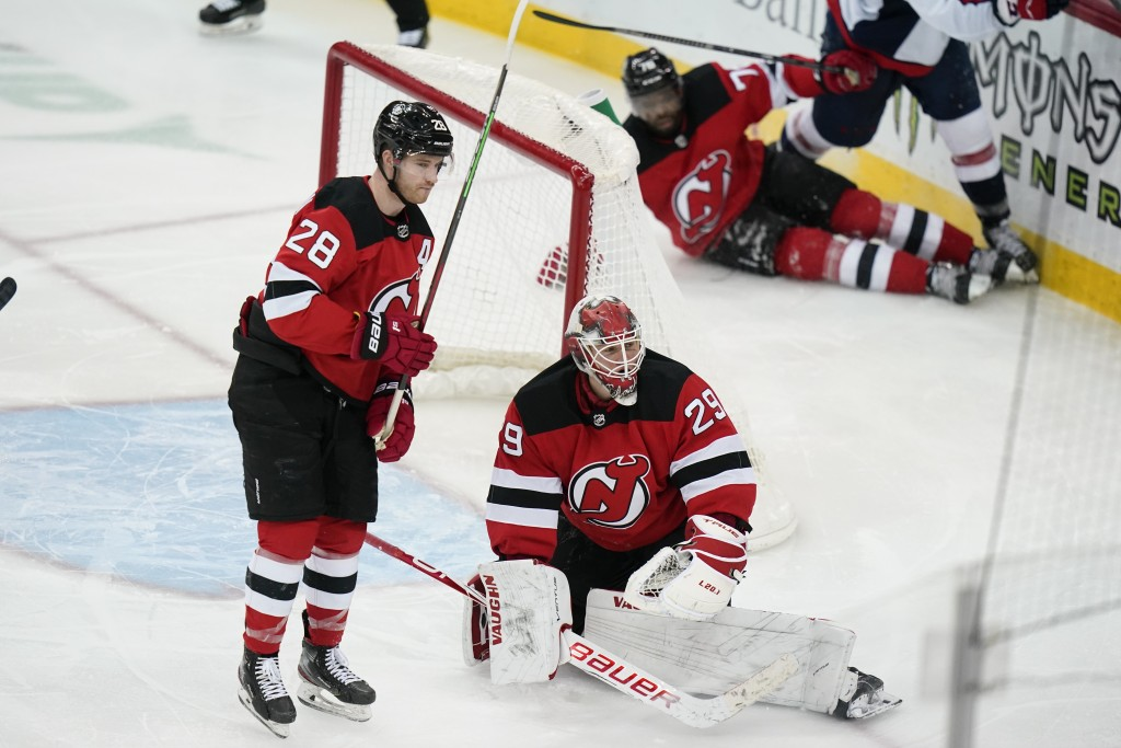 New Jersey Devils goaltender Mackenzie Blackwood (29) and teammates Damon Severson (28) and P.K. Subban react after Washington Capitals' Carl Hagelin ...