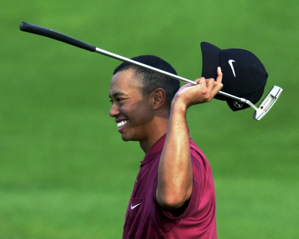 FILE - In this April 8, 2001, file photo, Tiger Woods smiles after winning the Masters at Augusta National Golf Club in Augusta, Ga. It was 20 years a...