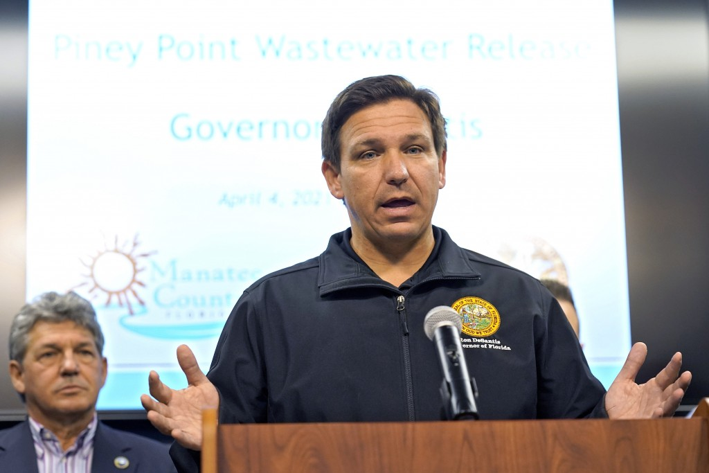 Florida Gov. Ron DeSantis gestures during a news conference Sunday, April 4, 2021, at the Manatee County Emergency Management office in Palmetto, Fla....