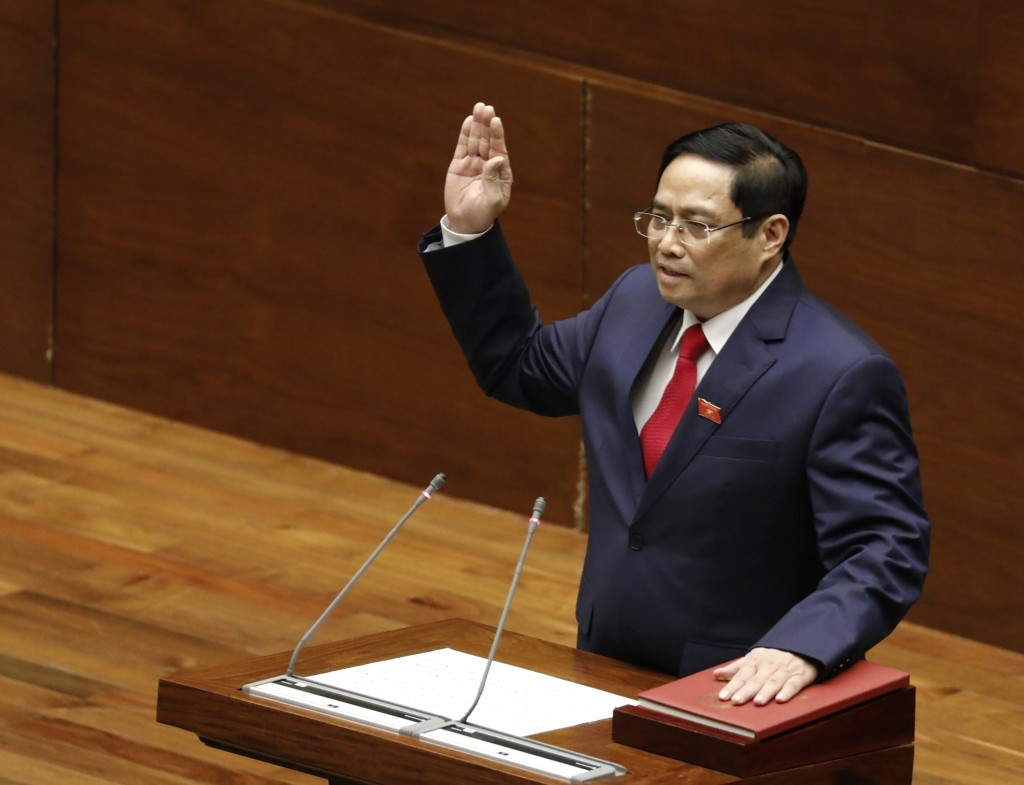 Vietnamese newly elected Prime Minister Pham Minh Chinh takes an oath in front of the National Assembly in Hanoi, Vietnam on Monday, April 5, 2021. Vi...