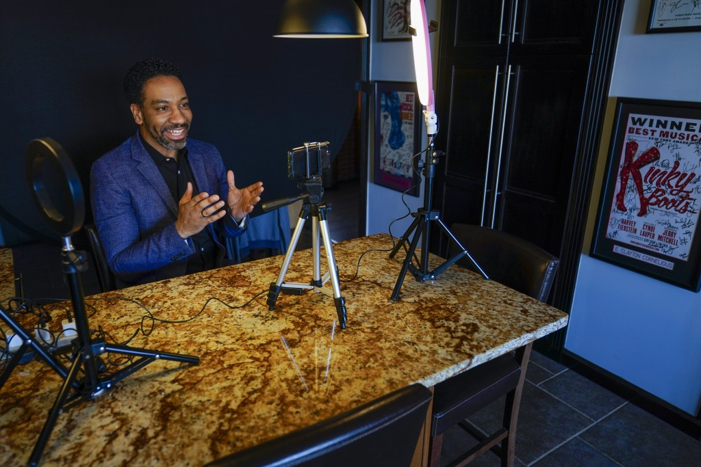 Actor E. Clayton Cornelious poses for a photo in the makeshift studio set up in his home for auditioning, Monday, March 22, 2021, in New York. He's lo...