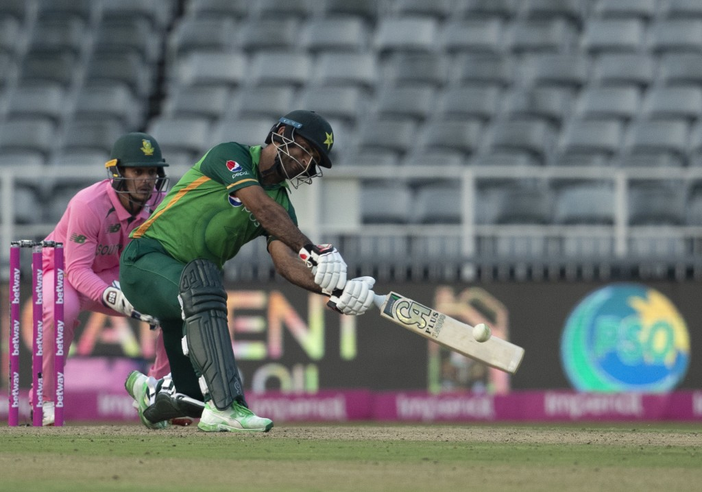 Pakistan's batsman Fakhar Zaman, right, plays a shot as South Africa's wicketkeeper Quinton de Kock watches on during the second One Day International...